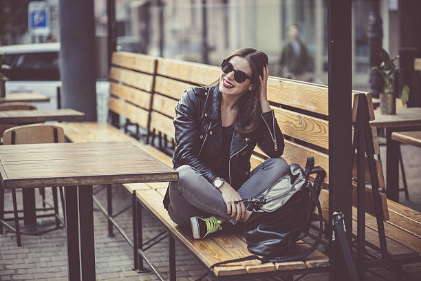 woman in the street cafe - lederjacke frauen stock-fotos und bilder