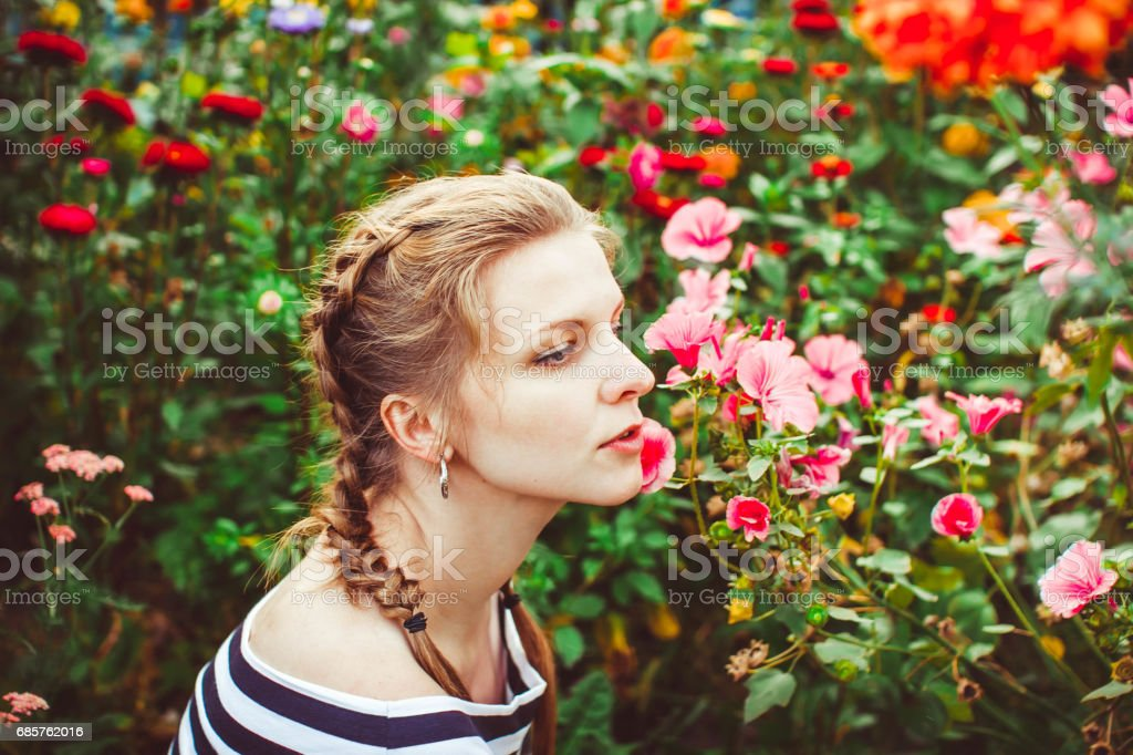 Woman in the summer garden foto stock royalty-free