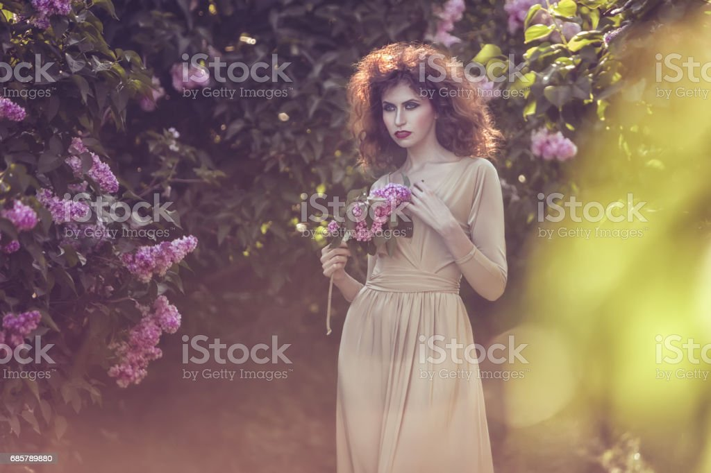 Woman in the sun in the park. stock photo