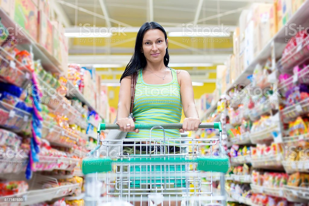 Woman in the supermarket stock photo