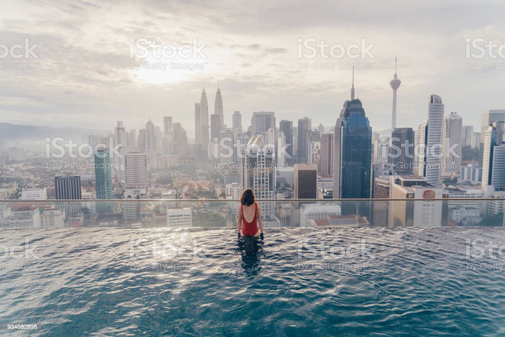 Woman in the swimming pool with view of kuala lumpur stock - Homestay in kuala lumpur with swimming pool ...