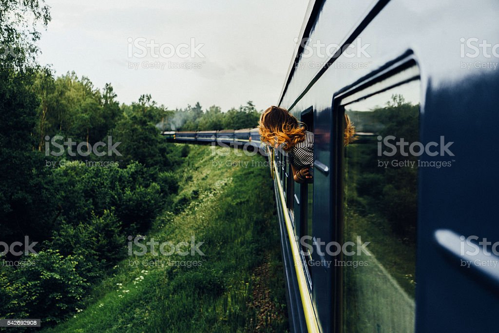 Woman in the  train stock photo