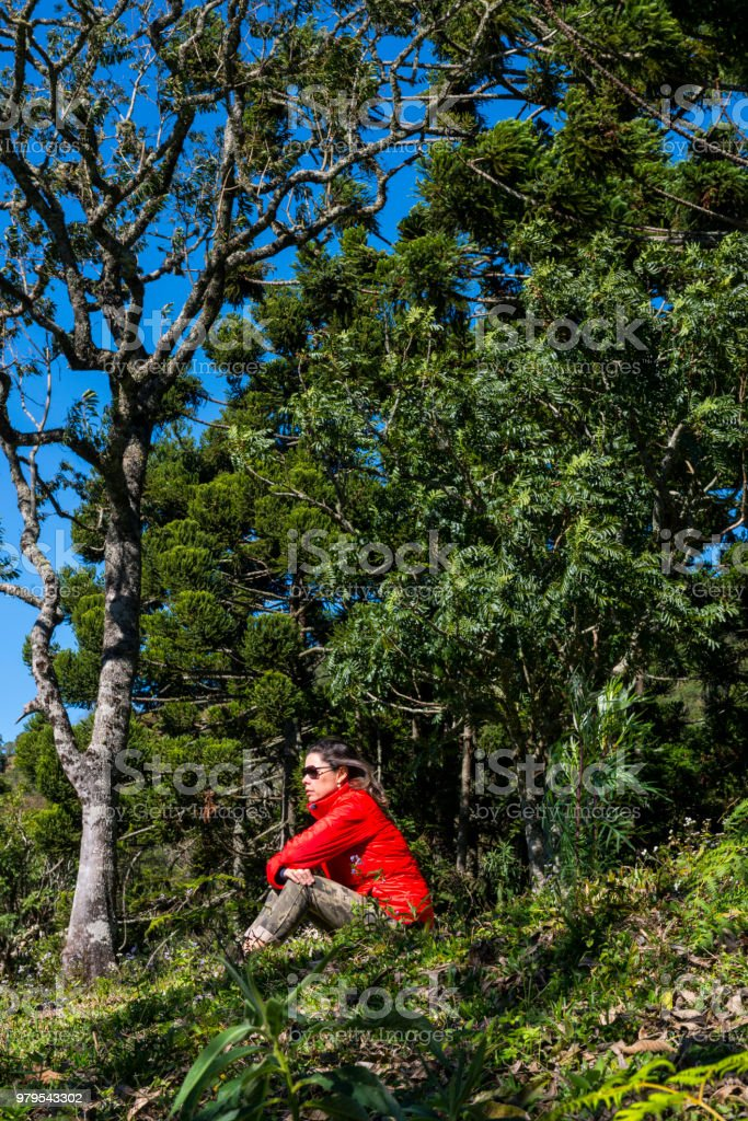 Woman in the woods looking to the hills in a winter day, Gonçalves, Minas Gerais stock photo