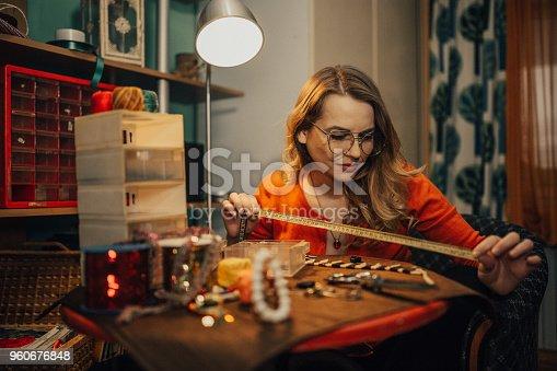 512345816istockphoto Woman in the workshop making bijouterie 960676848