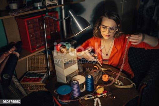 512345816istockphoto Woman in the workshop making bijouterie 960676980