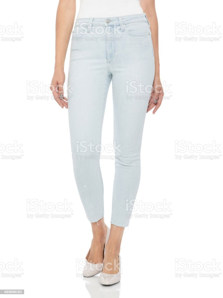 Woman in tight jeans and heels, white background stock photo