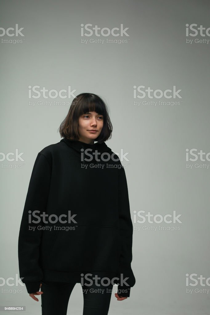 woman in total black outfit, isolated in studio stock photo