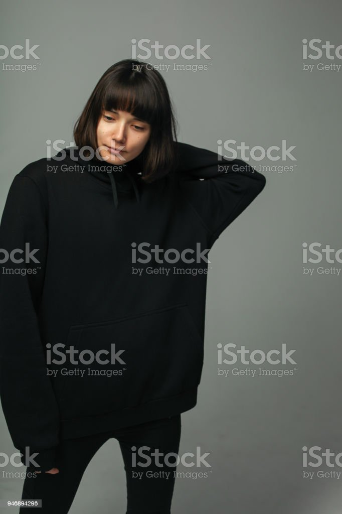 woman in total black outfit, posing stock photo