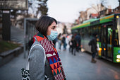 istock Woman In Town Wearing Protective Face Mask. 1204304023