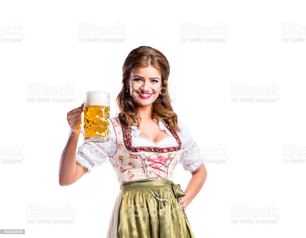 Woman in traditional bavarian dress holding beer - foto de stock