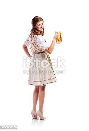 istock Woman in traditional bavarian dress holding beer 600000168