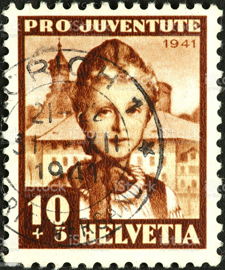woman in traditional dress on 1941 Swiss postage stamp royalty-free stock photo