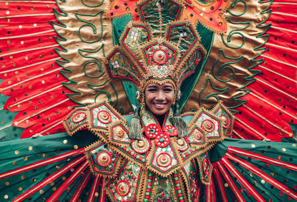 Woman in traditional Indonesian costume of Garuda during ritual dancing ceremony Asian woman in traditional Indonesian costume of Garuda performing ritual dancing ceremony smiling indonesia stock pictures, royalty-free photos & images