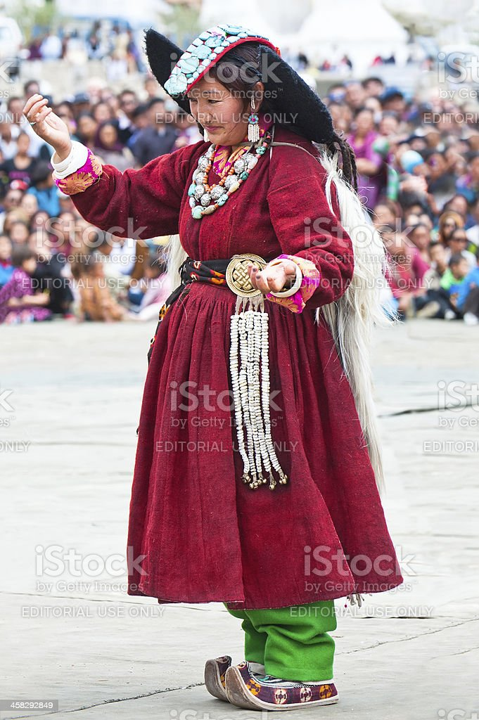 Woman in traditional Tibetan clothes performing folk dance royalty-free stock photo