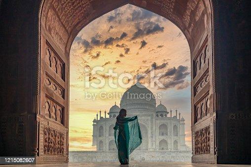 istock Woman in traditonal culture dress saree or sari in the Taj Mahal, Taj Mahal is most beautiful white marble mausoleum in the Indian city, Agra, Uttar Pradesh, India. 1215082607