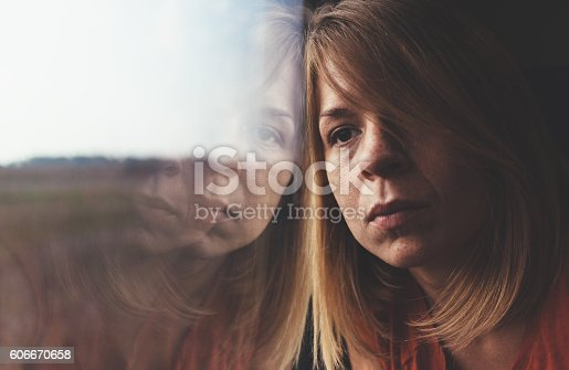 istock Woman in train alone and sad 606670658