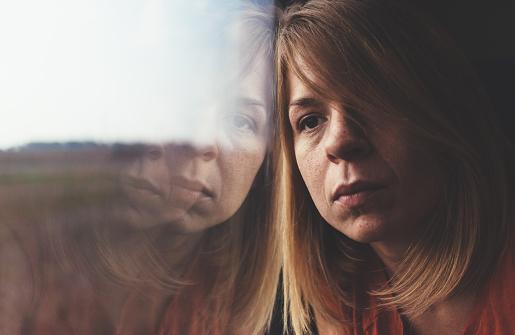 istock Woman in train alone and sad 606670658