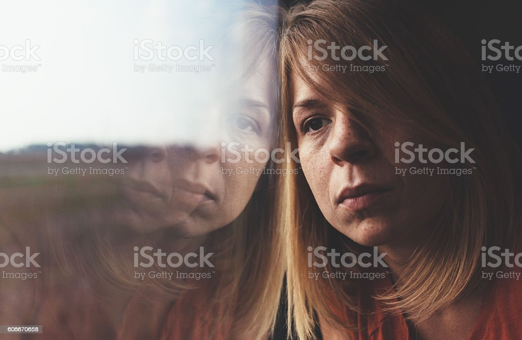 Woman in train alone and sad stock photo