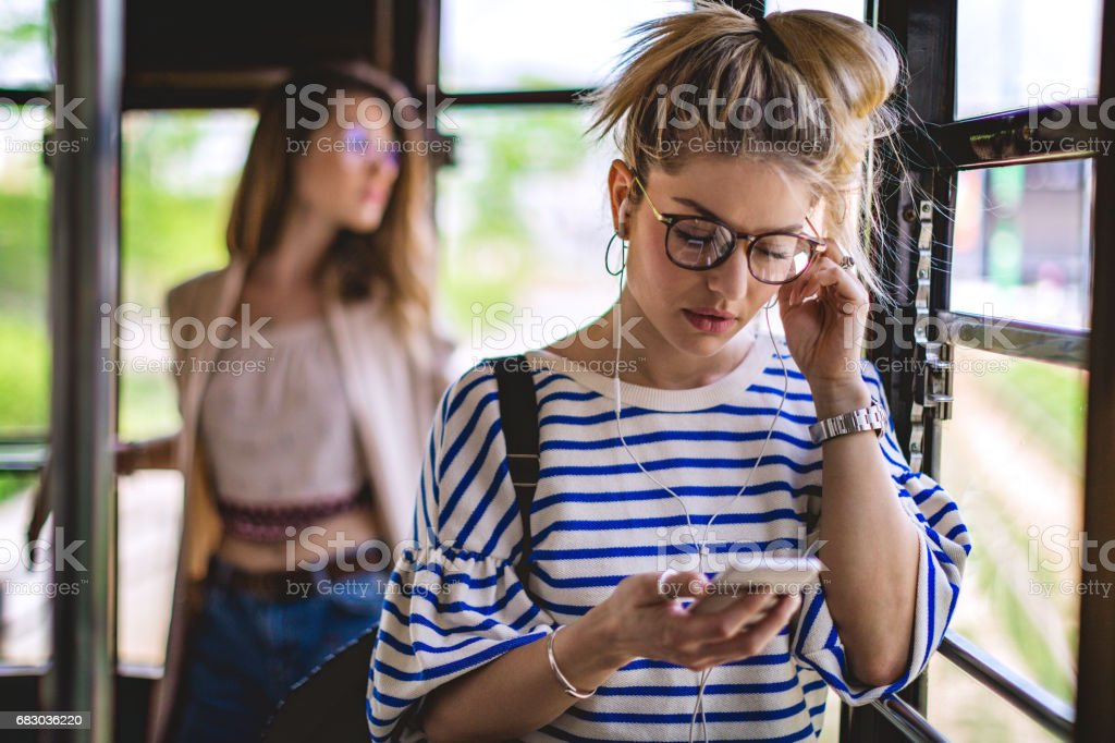 Woman in train with smartphone foto de stock royalty-free