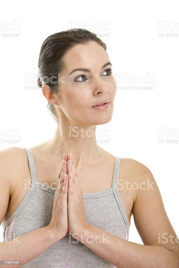 Woman in training outfit folding hands stock photo