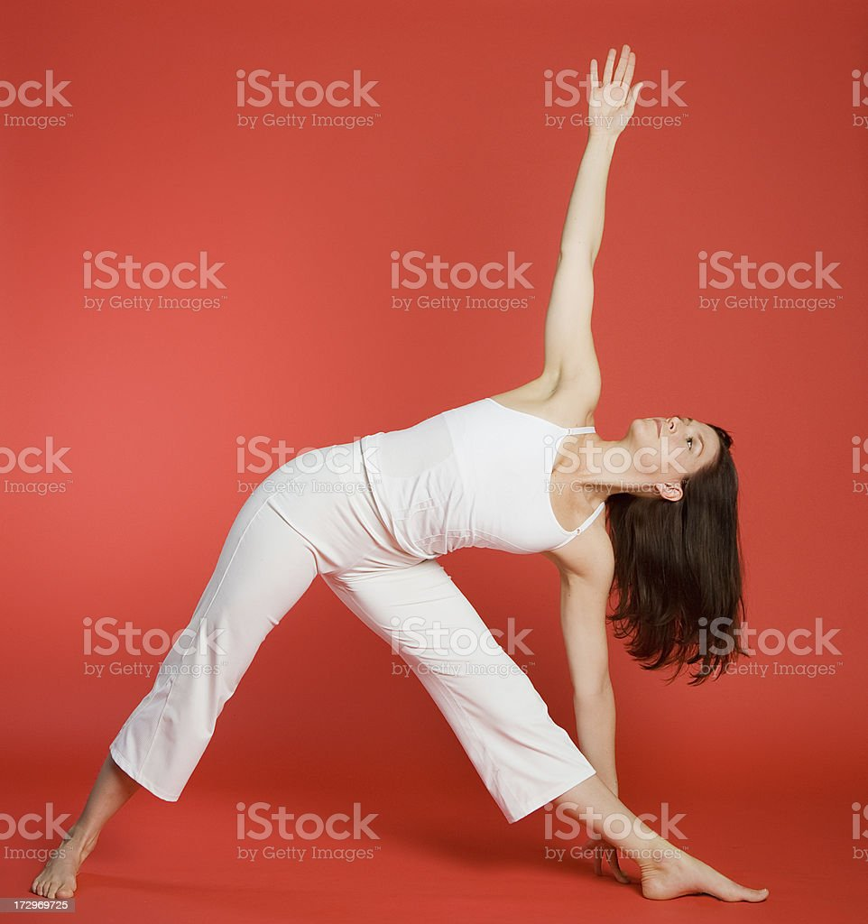 Woman in triangle pose royalty-free stock photo