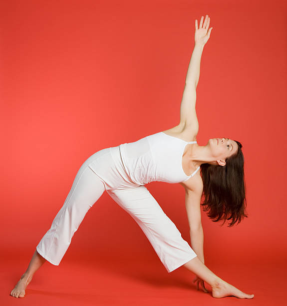 Woman in triangle pose stock photo