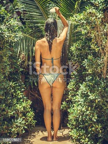 Woman in tropical beach shower