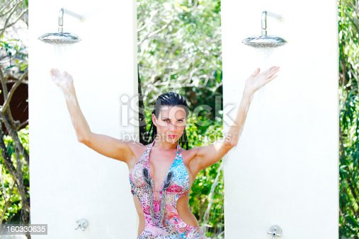 545091450istockphoto Woman in tropical shower 160330635
