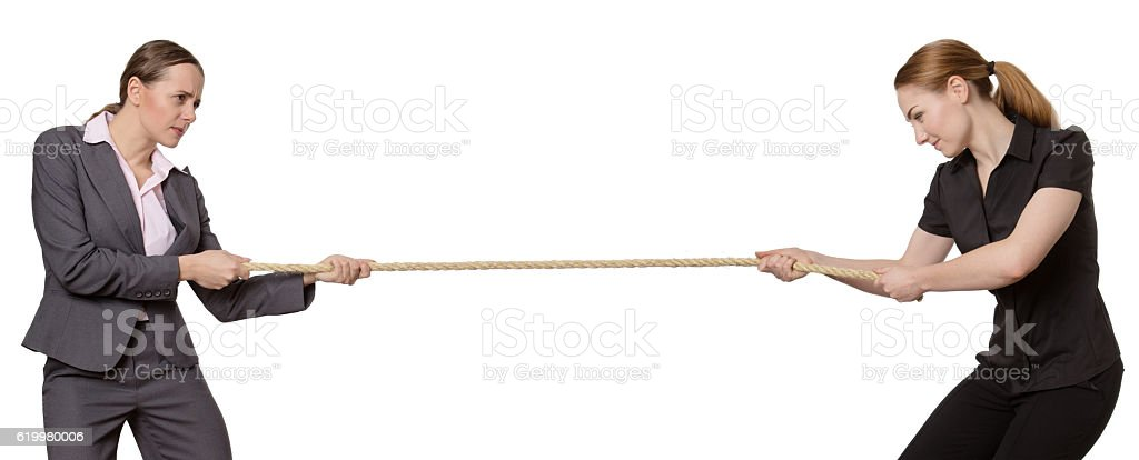 woman in tug of war stock photo