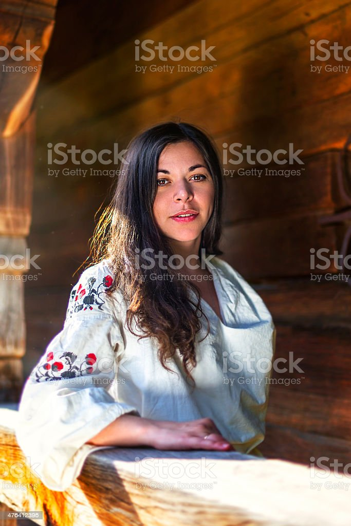 Woman in ukrainian national costume at the sun-parlour stock photo