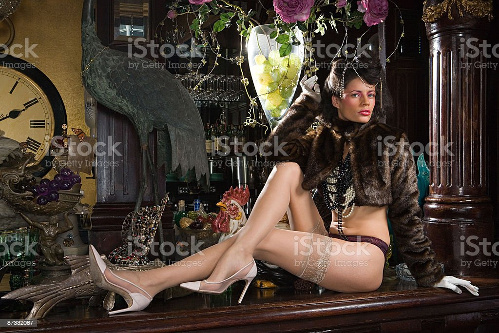 Woman in underwear reclining on a bar top royalty-free stock photo