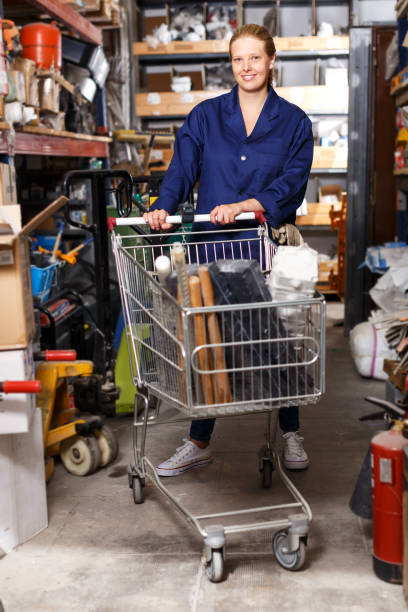 Woman in uniform posing in build shop stock photo