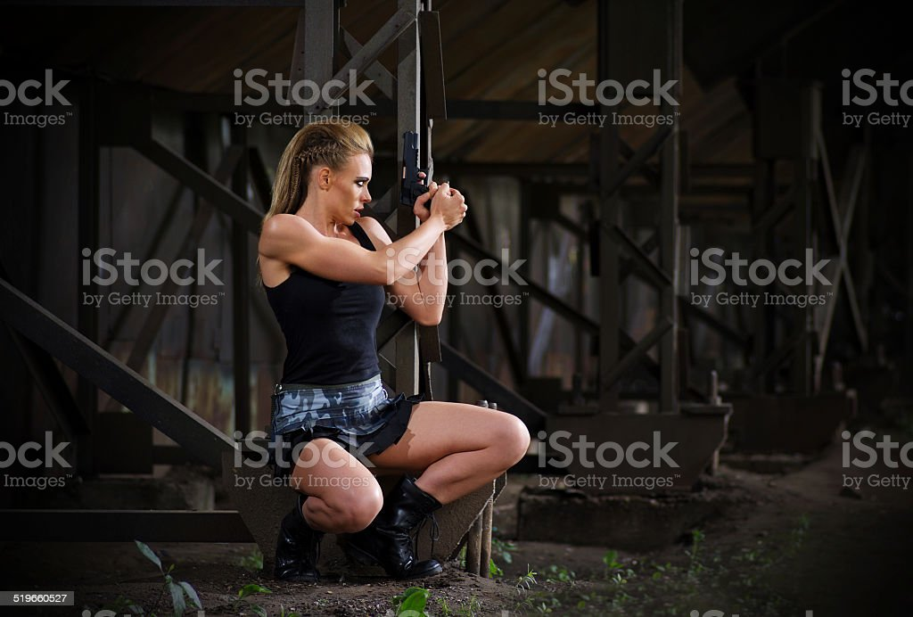 Woman in uniform with gun (normal version) stock photo