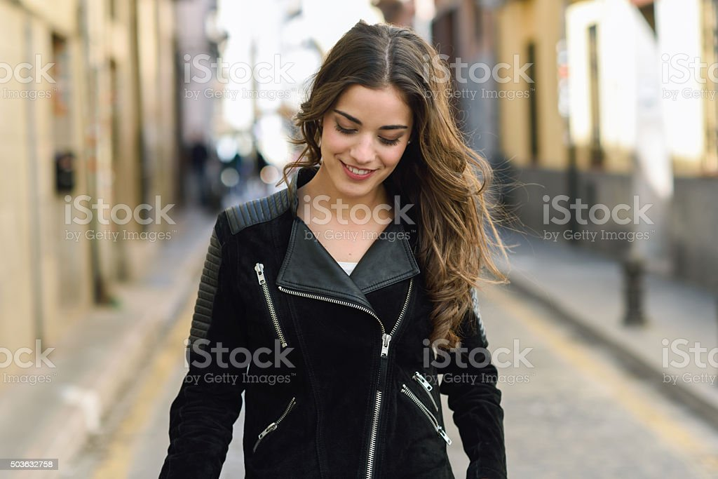 Woman in urban background wearing casual clothes stock photo