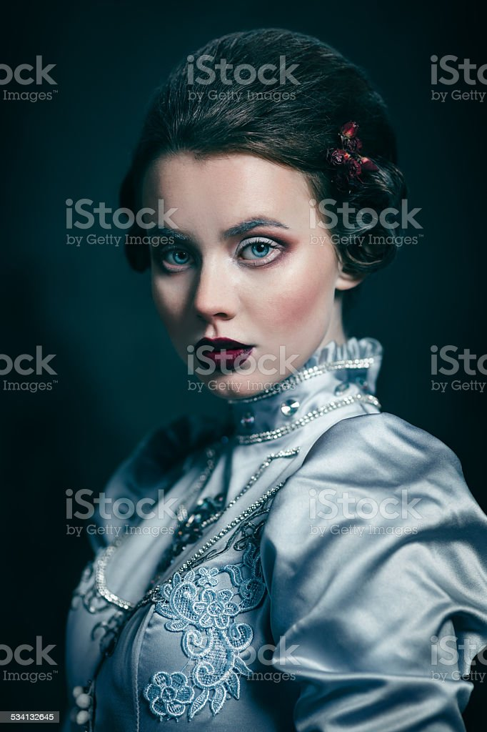 Woman in victorian dress stock photo