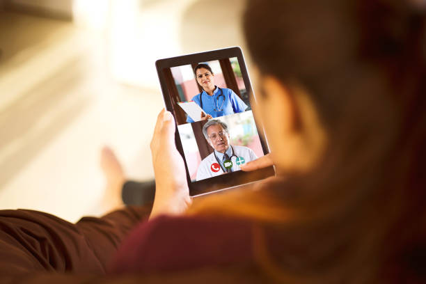 Woman in video conference with doctor stock photo