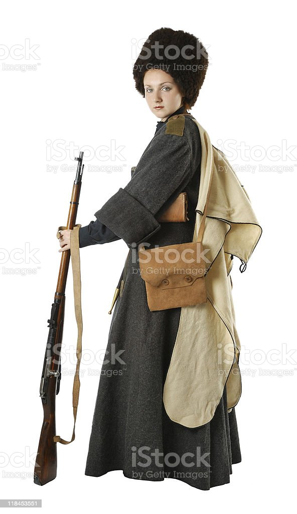 Woman in vintage costume of Russian Cossack with a rifle. stock photo