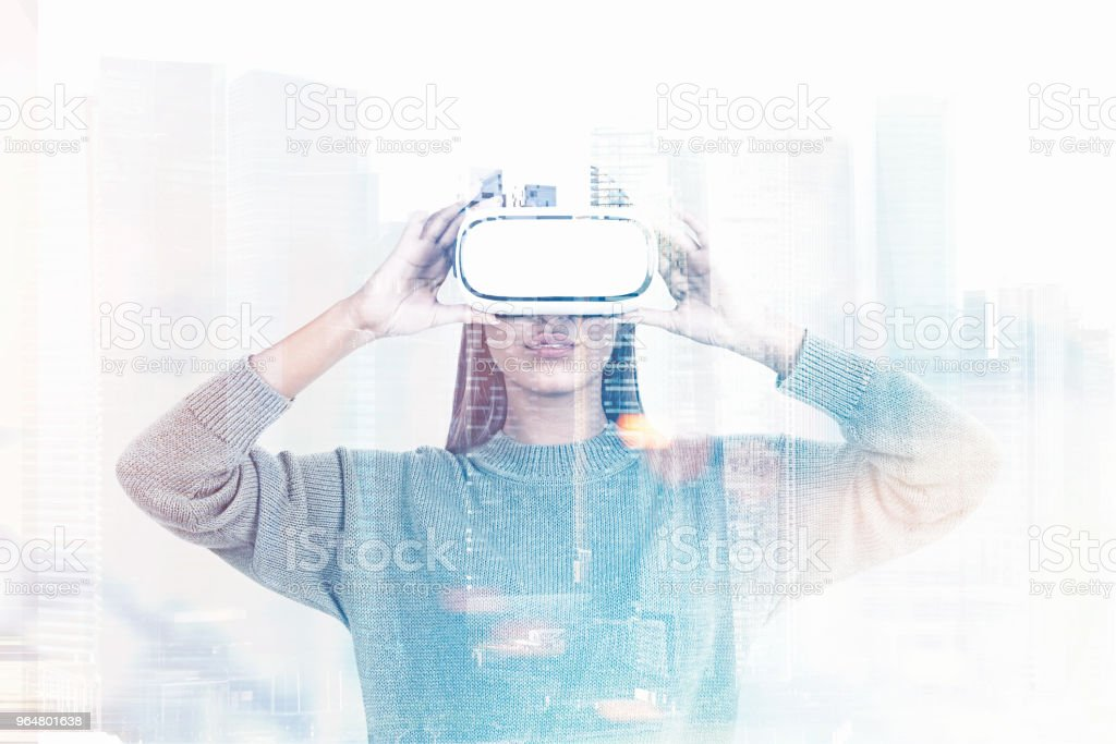 Woman in VR glasses, foggy cityscape royalty-free stock photo