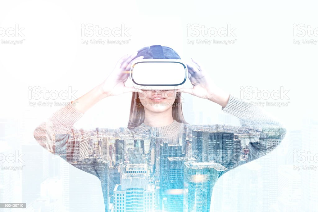 Woman in VR glasses, modern cityscape royalty-free stock photo