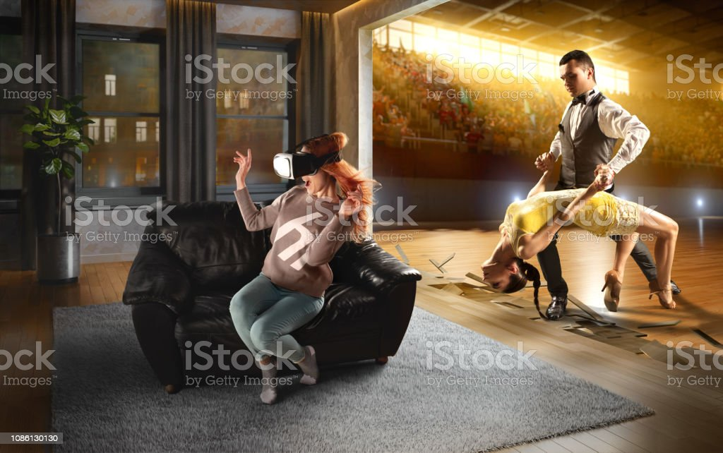 Woman in VR Glasses. Virtual Reality with Dancing stock photo