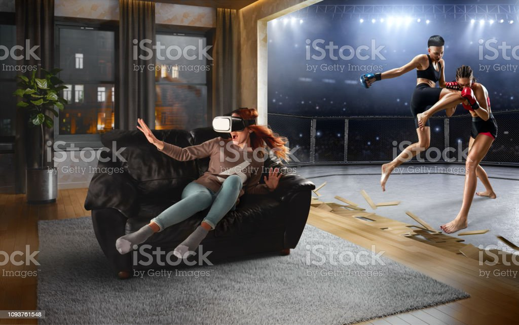 Woman in VR Glasses. Virtual Reality with female Mixed Martial Arts stock photo