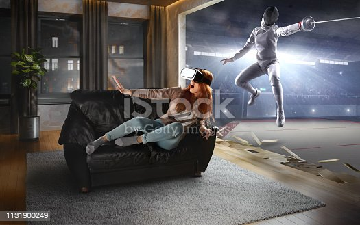 istock Woman in VR Glasses. Virtual Reality with Fencing 1131900249