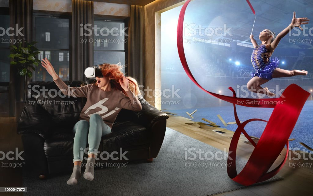 Woman in VR Glasses. Virtual Reality with Gymnastics stock photo