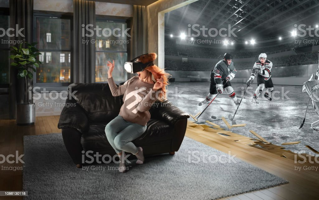 Woman in VR Glasses. Virtual Reality with Hockey stock photo