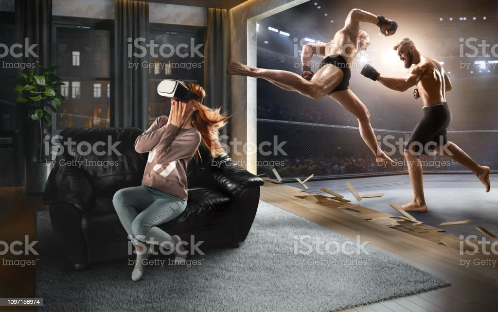 Woman in VR Glasses. Virtual Reality with Mixed Martial Arts stock photo