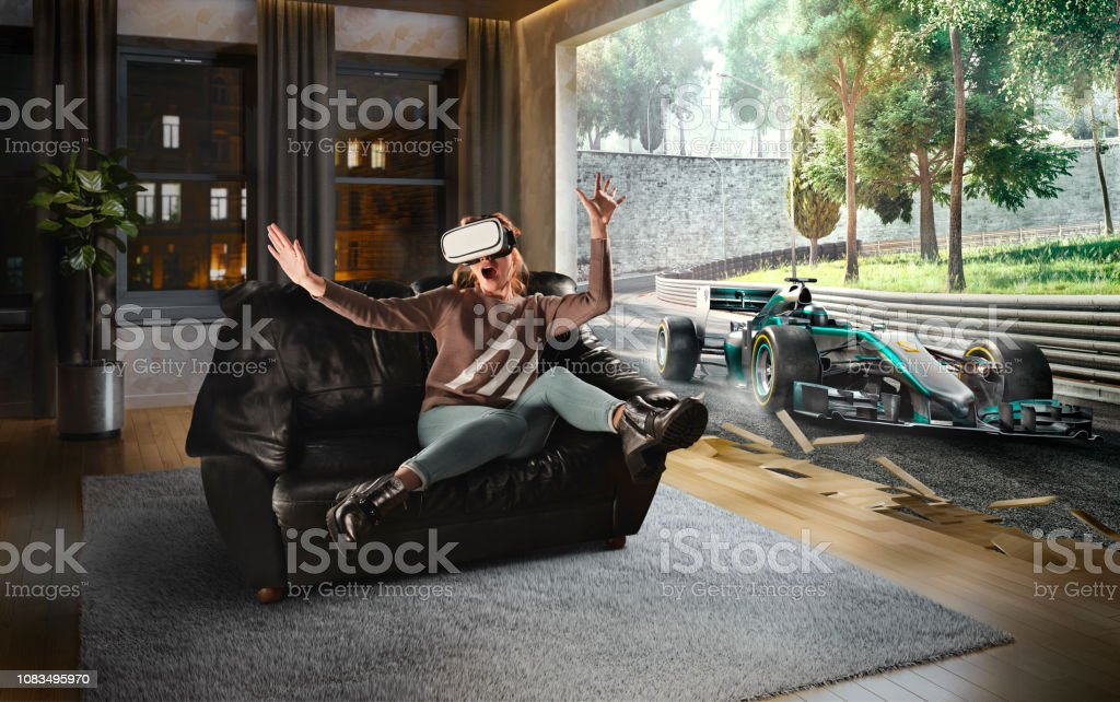 Woman in VR Glasses. Virtual Reality with racing cars on the track stock photo