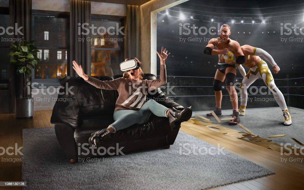 Woman in VR Glasses. Virtual Reality with Wrestling stock photo