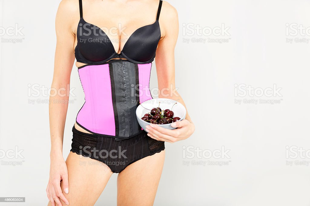 Woman in waist training corset stock photo