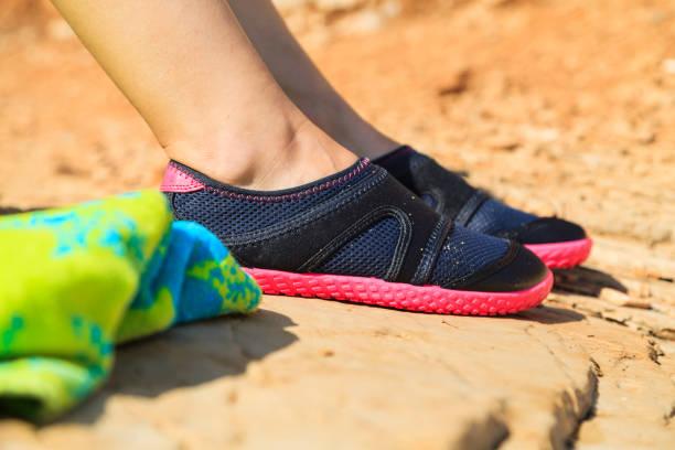 Woman in water shoe – Foto