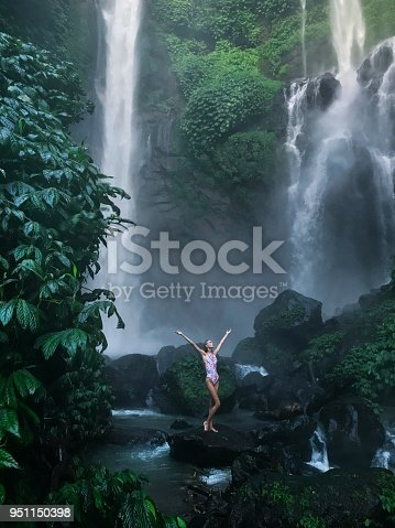 istock Woman in waterfall 951150398